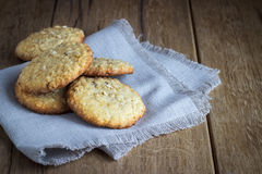 Oatmeal cookies on white linen napkin on wooden royalty free stock photo