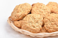 Oatmeal cookies in wicker bowl Stock Image