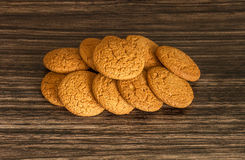 Oatmeal cookies. On a wooden background Royalty Free Stock Photos