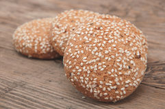 Oatmeal cookies on a wooden background. Some oatmeal cookies with sesame seeds on a wooden background Stock Image
