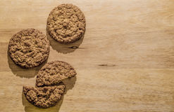 Oatmeal cookies on a wooden board. Brown background for an inscription Stock Images