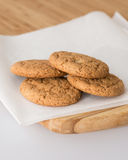 Oatmeal cookies on a wooden board. Close up Stock Photography