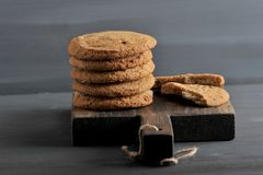 Oatmeal cookies on a wooden rustic Board Royalty Free Stock Photos