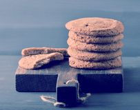 Oatmeal cookies on a wooden rustic Board Stock Photography
