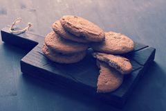 Oatmeal cookies on a wooden rustic Board Stock Images