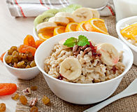 Oatmeal, cottage cheese, milk and fruit Stock Photo