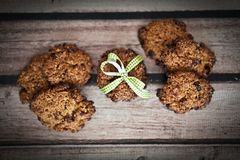 Oatmeal cranberry cookies. Wood table Royalty Free Stock Photography