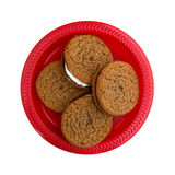Oatmeal crème cookies on a red plate Royalty Free Stock Photography