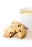 Oatmeal crumbled  cookie with raisins and cup of green tea on  w Royalty Free Stock Images