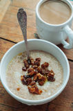 Oatmeal with dates and coffee. Oatmeal with butter and dates and coffee with milk Stock Photos