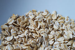 Oatmeal. Detail at oatmeal on blue background Royalty Free Stock Photography