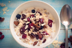 Oatmeal with dried fruit. Stock Photo