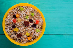 Oatmeal with dried fruit strawberries, grapes, kiwi, peach. O Royalty Free Stock Images