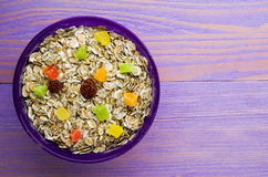 Oatmeal with  dried fruit strawberries, grapes, kiwi, peach . Royalty Free Stock Image