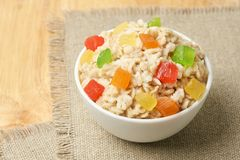 Oatmeal with dried fruits. Bright colors. Useful breakfast. Tasty oatmeal with dried fruits. Bright colors. Useful breakfast. Healthy food Stock Images