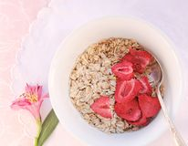 Oatmeal with dried strawberries Royalty Free Stock Photography