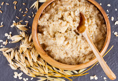 Oatmeal and ears of corn oat Royalty Free Stock Photography