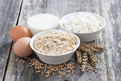 Oatmeal, eggs, cottage cheese and glass of milk Royalty Free Stock Photography