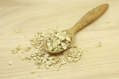 Oatmeal filled in the a spoon Royalty Free Stock Images