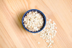 Oatmeal flakes. In a  bowl Royalty Free Stock Images