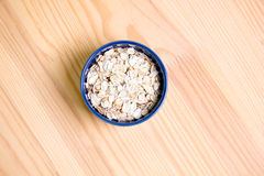 Oatmeal flakes. In a  bowl Royalty Free Stock Photo