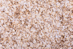 Oatmeal flakes. Close up as background Stock Photos