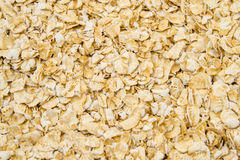 Oatmeal flakes close up as background Royalty Free Stock Photo
