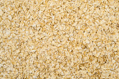 Oatmeal flakes close up as background. Oatmeal flakes close up shot as background stock photo