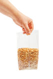 Oatmeal flakes into hand. Royalty Free Stock Photography