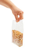 Oatmeal flakes into hand. Royalty Free Stock Image