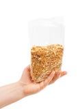 Oatmeal flakes into hand. Stock Photos