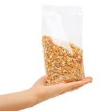 Oatmeal flakes into hand. Stock Photo