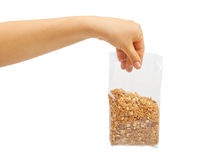 Oatmeal flakes into hand. Stock Images