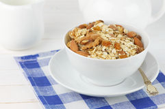 Oatmeal flakes with nuts in bowl Royalty Free Stock Image