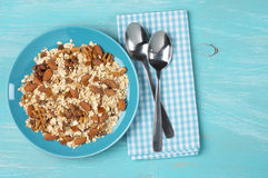 Oatmeal flakes with nuts in plate Stock Photos