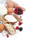 Oatmeal, flour, eggs, berries - ingredients for baking Stock Image