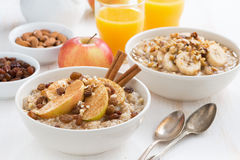 Oatmeal with fresh apples, raisins and cinnamon for breakfast. On white table, close-up Royalty Free Stock Photos