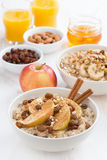 Oatmeal with fresh apples, raisins and cinnamon for breakfast Stock Image