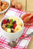 Oatmeal with fresh berries, bananas nuts and honey.  Healthy Breakfast Royalty Free Stock Image