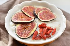 Oatmeal with fresh figs and goji berry Stock Photo