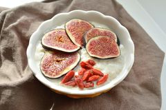 Oatmeal with fresh figs and goji berry Stock Photos