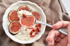Oatmeal with fresh figs and goji berry Royalty Free Stock Images