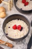 Oatmeal with fresh raspberries for a tasty and healthy breakfast. Still life close-up Stock Image