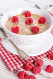 Oatmeal with fresh raspberry Stock Photo