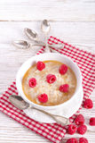 Oatmeal with fresh raspberry Royalty Free Stock Photography