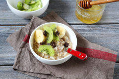 Oatmeal with fruit in a bowl Stock Images