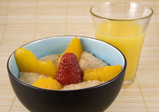 Oatmeal with Fruit and Glass of Orange Juice Stock Image
