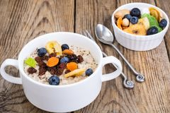 Oatmeal with fruit and nuts-hearty and tasty breakfast Stock Photography