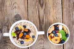 Oatmeal with fruit and nuts-hearty and tasty breakfast Stock Photos
