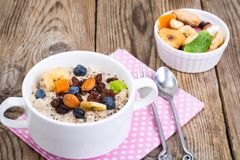 Oatmeal with fruit and nuts-hearty and tasty breakfast Stock Images